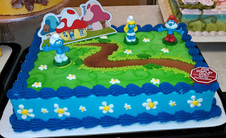 Elaborately decorated Smurfs cake