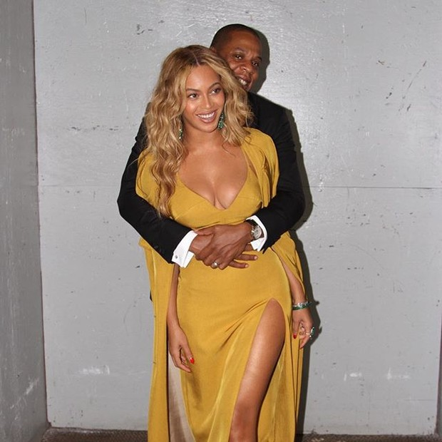 Booby, embraced by her husband, Jay - Z Beyonce poses