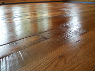 reclaimed oak floor by http://www.huismanconcepts.com/