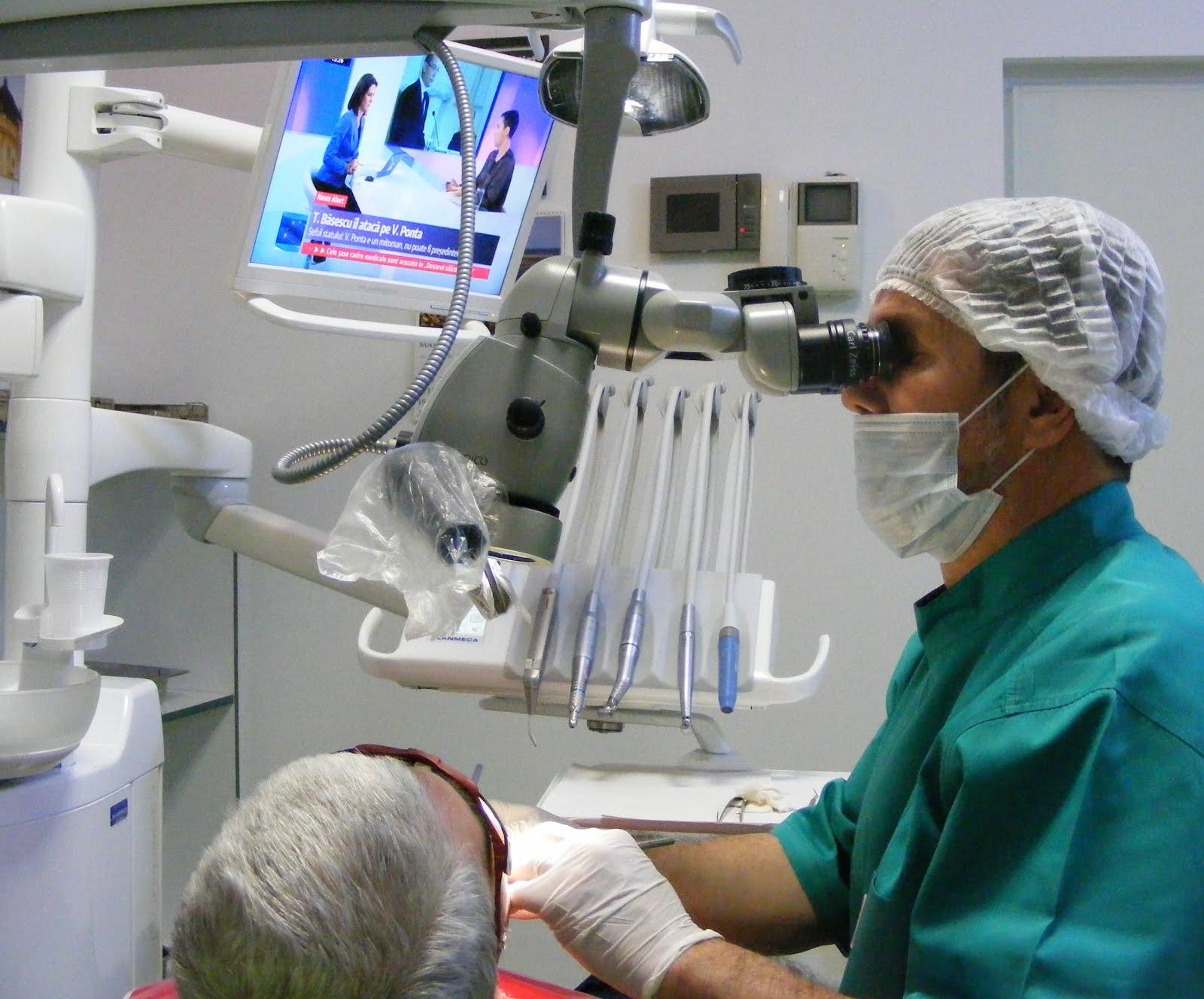 Dr Cazacu working on dental microscope