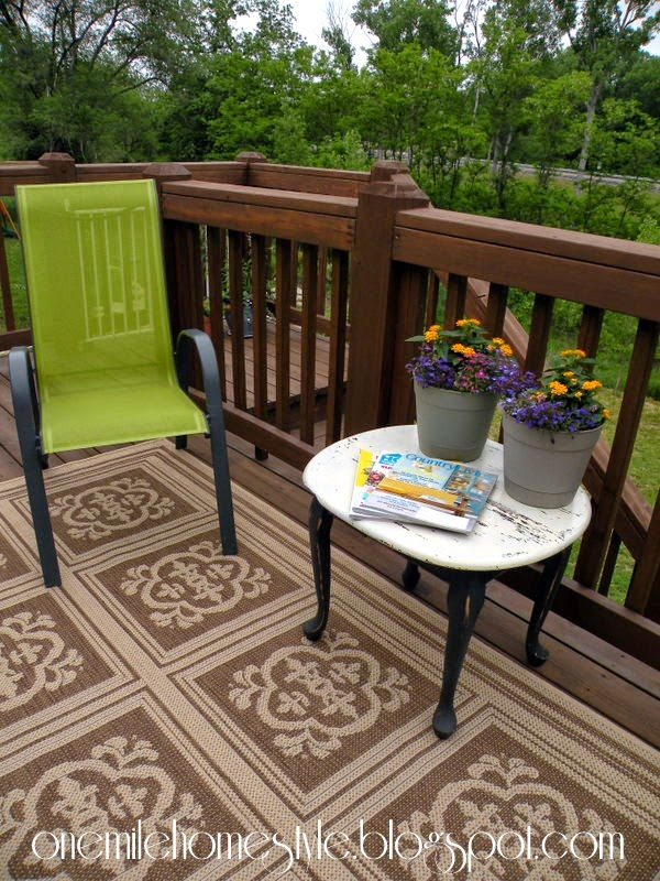 Deck Space with green chairs and white tables