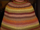 Knitted poncho out of mushroom and plant dyed woolyarn