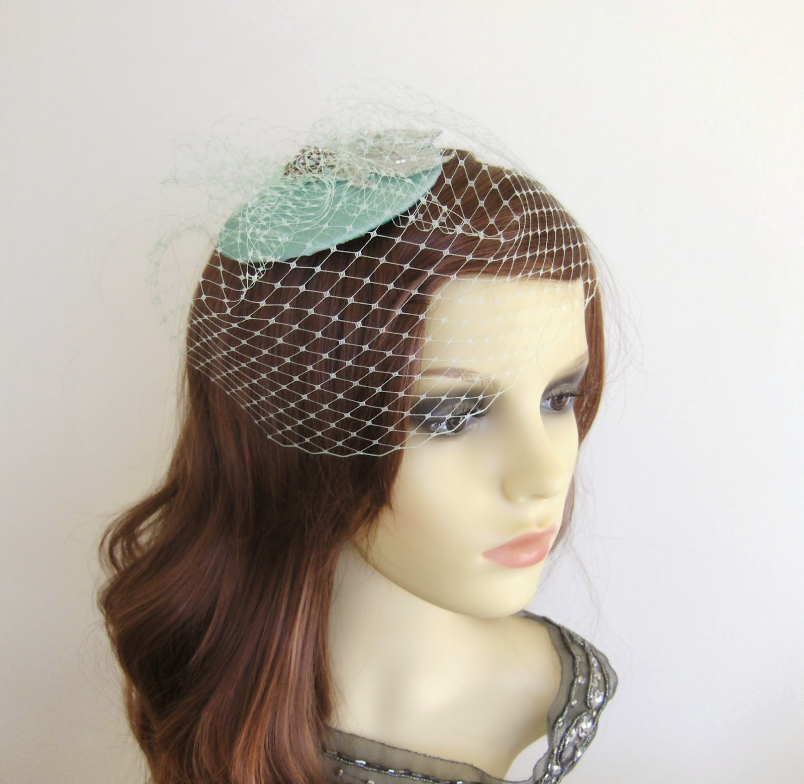 https://www.etsy.com/uk/listing/175607061/mint-green-veil-cocktail-hat?ref=shop_home_active_9