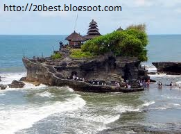 Tanah Lot a Hindu Temple in Bali People Swimming