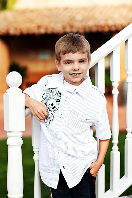 Boy posing for a family portrait outdoors in Tucson