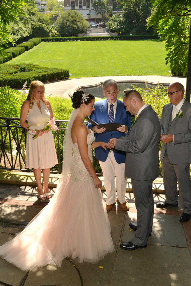 Groom puts on the Ring - Wisteria Pergola