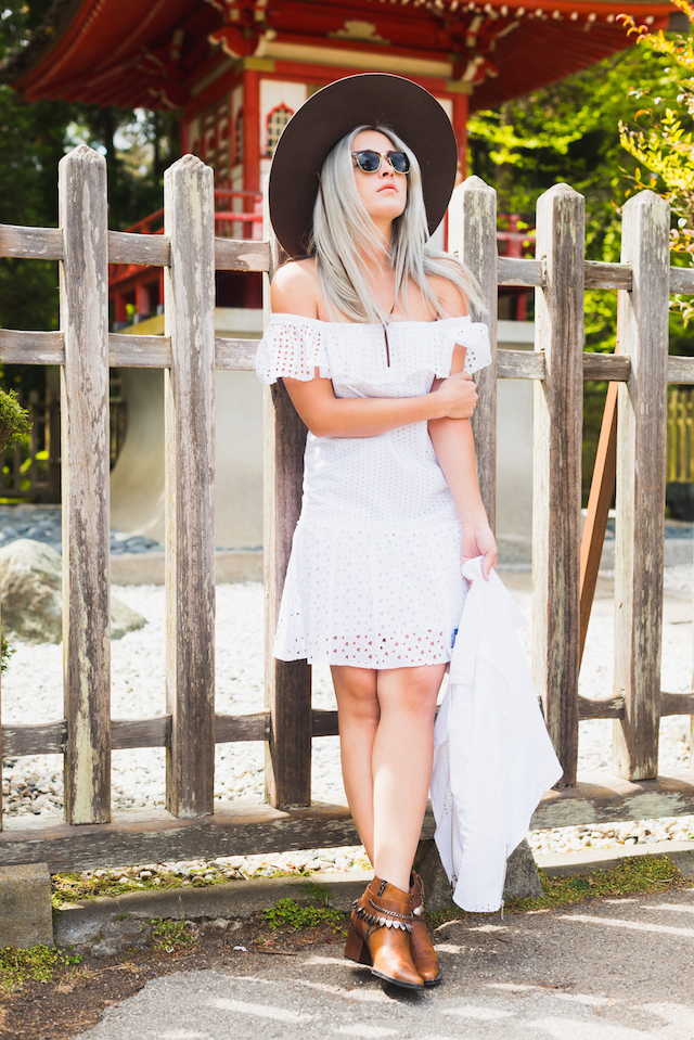 Bryn Newman of Stone Fox Style in a Rebecca Minkoff Eyelet jacket and dress at the Japanese Tea Gardens in San Francisco. Perfect summer outfit idea with a fun Brixton Hat and these fringe statement boots by Freda Salvador!