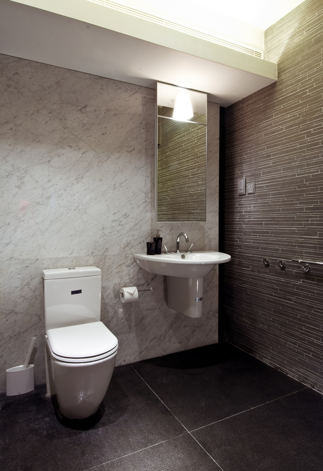 Picture of white modern bathroom furniture as part of the Hong Kong apartment design