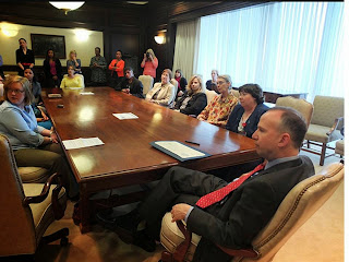 Moran participates in a Sexual Assault Awareness event with Delaware Gov. Jack Markell.