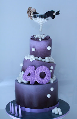 The topsy turvy bubbly cake. The 40 is completely covered in purple ...