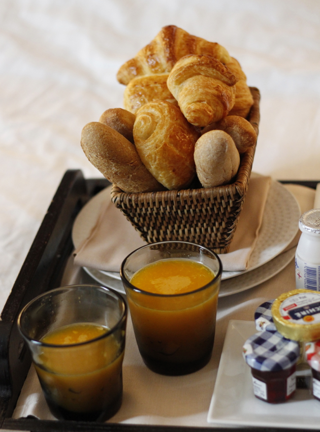 close-up of breakfast basket of rolls and croissants