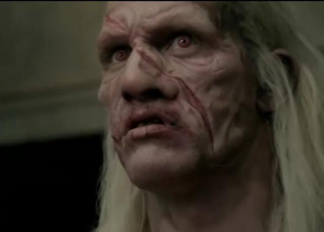 Theokoles rosto, Theokoles olhar, Theokoles cicatrizes, gigante