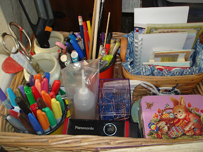 Basket of office supplies divided up into organized sections
