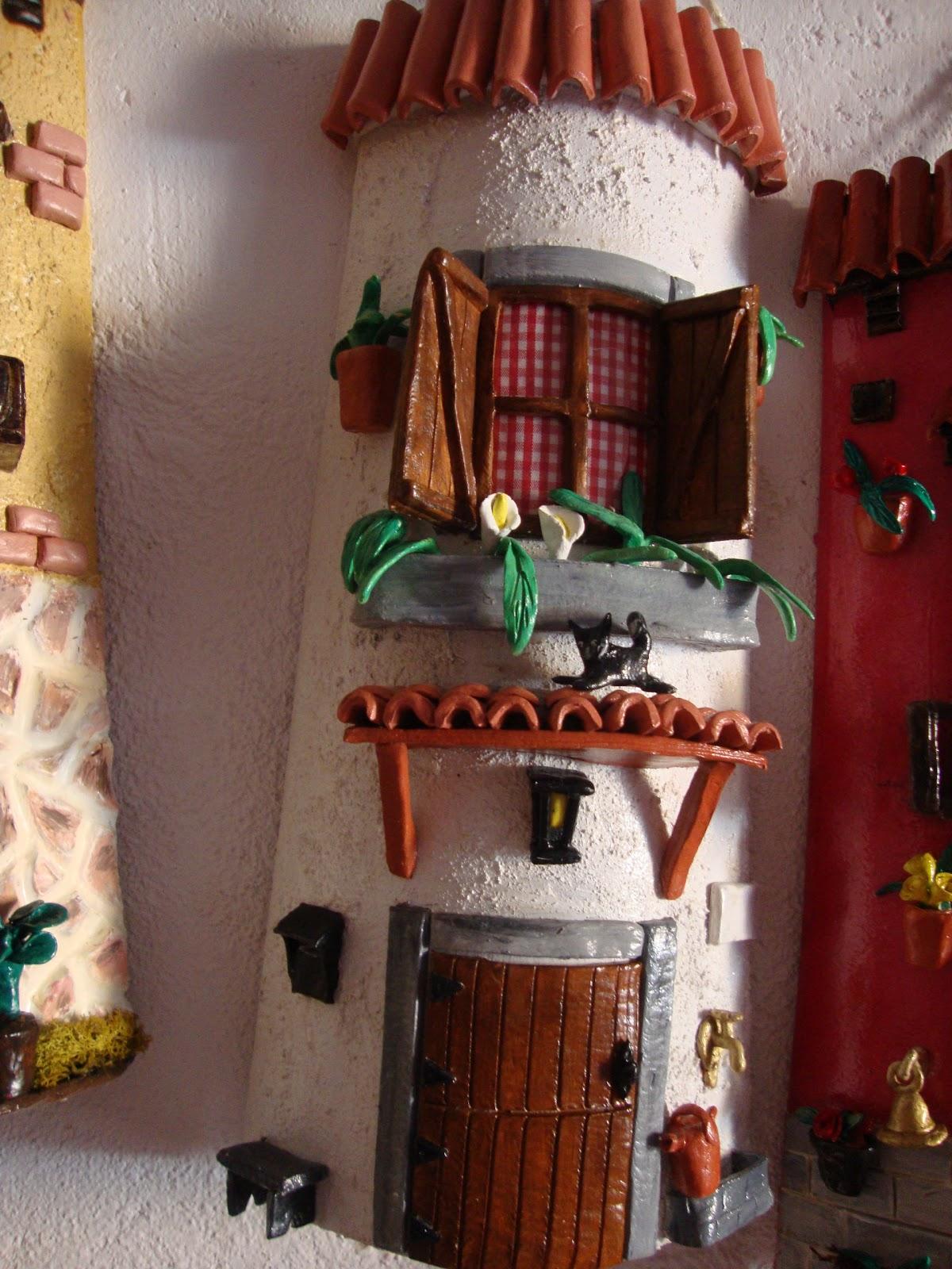 Tejas decoradas 2011 08 14 for Puertas de tejas decoradas