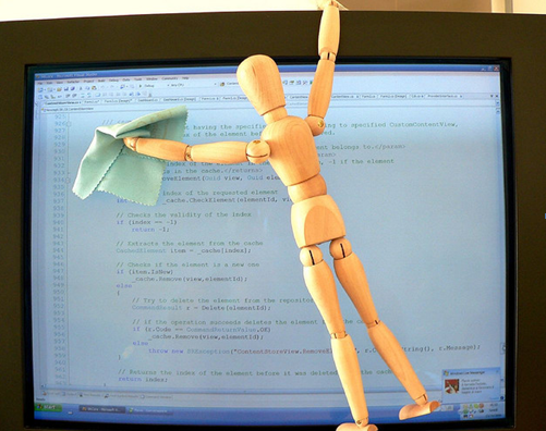 A wooden toy wiping monitor that is displaying code