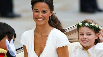 Pippa Middleton smiles as she travels in the Royal Carriage. YouTube 2011.