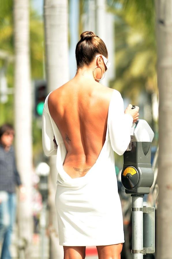 Jennifer Nicole Lee wearing a dangerously low cut dress for shopping in Beverly Hills