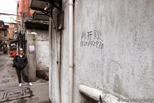 China's Yellow Pages, tradesmen leave their advertising scribbles on houses once their work is finished photograph