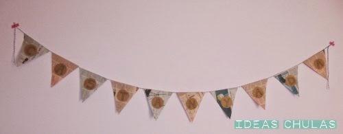 Guirnalda de papel para la Castanyada colocada en la pared