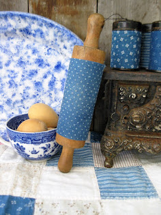 early blue calico on a child's rolling pin