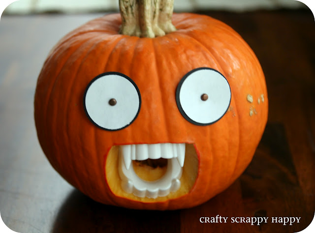 simple pumpkin with draculavampire teeth dentures - Pumpkin Halloween Ideas