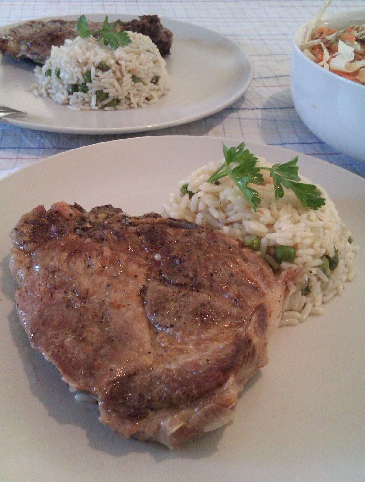 Pork steaks in the oven with rice