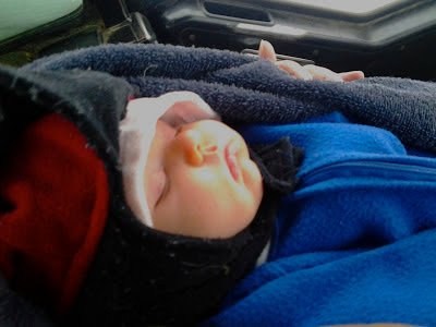 sleeping baby all bundled up in winter clothes