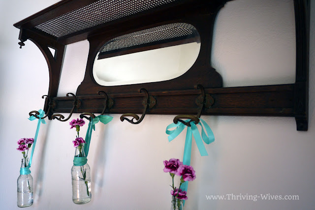vintage home decor coat rack and bottles as vases