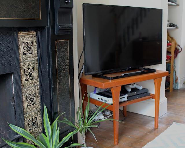 Mid century modern style teak tv table