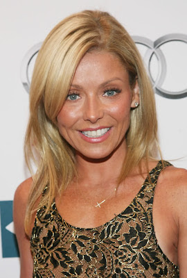 Kelly Ripa Wearing a Side Cross Necklace