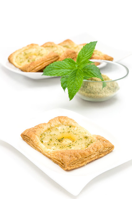 Pineapple puff pastry dessert with mint sugar close up on a plate
