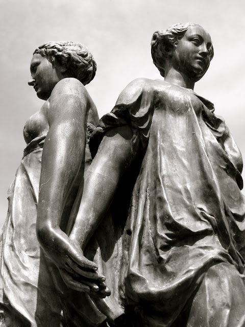 3 women holding hands statue photograph