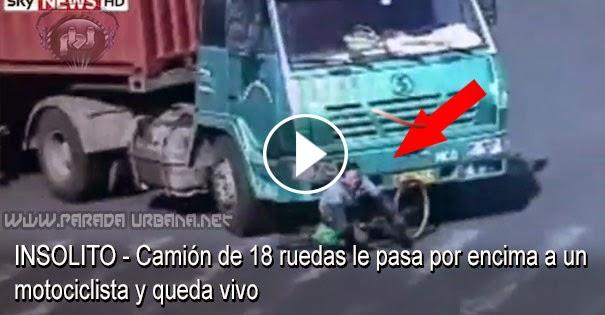 VIDEO INSOLITO - camión de 18 ruedas le pasa por encima a un motociclista y queda vivo