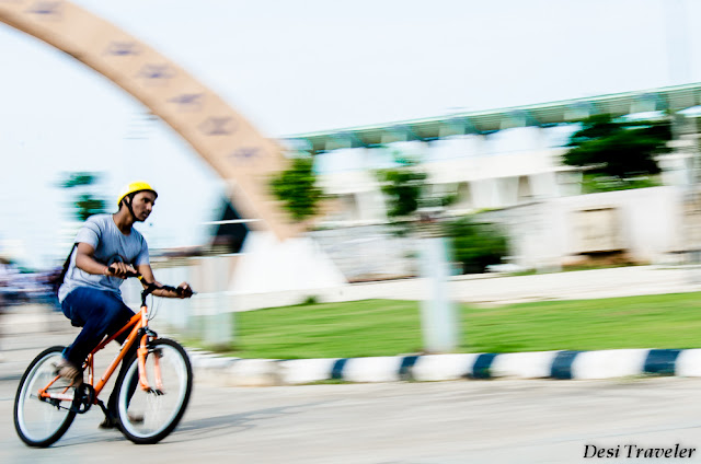 man on cycle with helmet