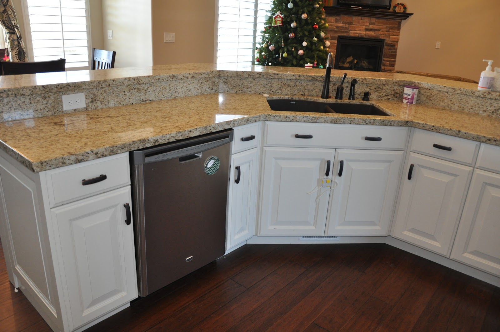 Stone ridge cabinets kitchen cabinets off white with black walnut hood - Pictures of off white kitchen cabinets ...