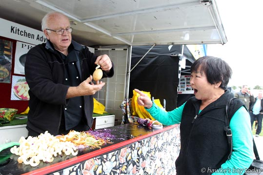 L-R: Frank Roebuck, Kitchen Adventures Ltd, Taranaki, demonstrating a curly fry gourmet skewer to Chieko Dietz, Taradale, Napier, at the Hawke's Bay Home and Garden Show at McLean Park, Napier. photograph