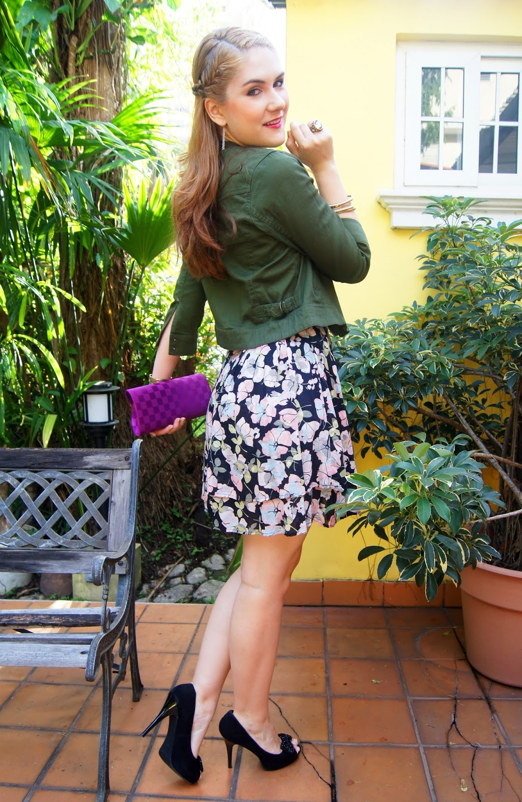 Make a cargo jacket look more girly by pairing it with a floral dress!