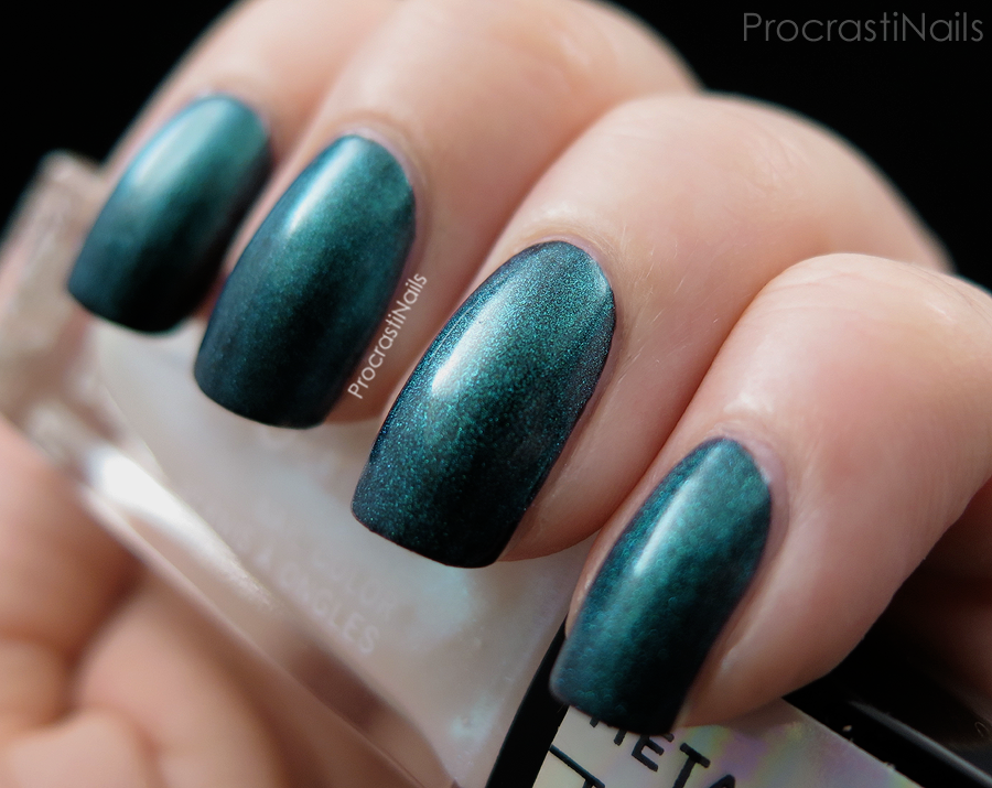 Swatch of Julep Tilda Metamorphic Top Coat over black from the January 2015 Julep Maven Box