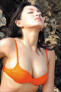 hot Karina Emira  in a Orange Bikini Swimsuit