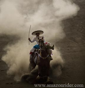An amazon rider breaks on her horse during an escaramuza fair. Photo by Leslie Mazoch