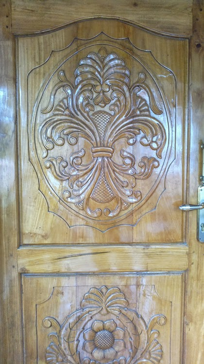New kerala style main door carving wood work designs new for Main door designs 2014