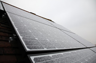 Frosty solar panels in winter