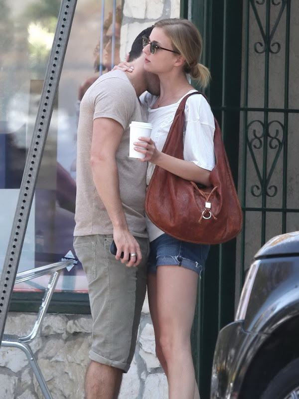 Emily VanCamp and Josh Bowman showing some affection on the street