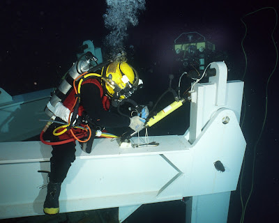 diver conducts deep sea salvage operations