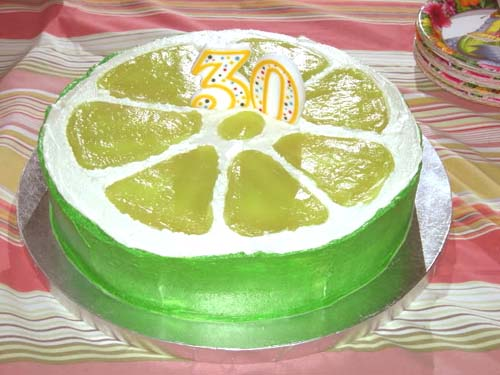 birthday cake decorated with buttercream icing to look like a slice of lime