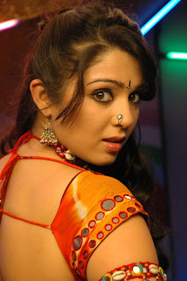 Telugu Actress Charmi Spicy Stills in Red Saree