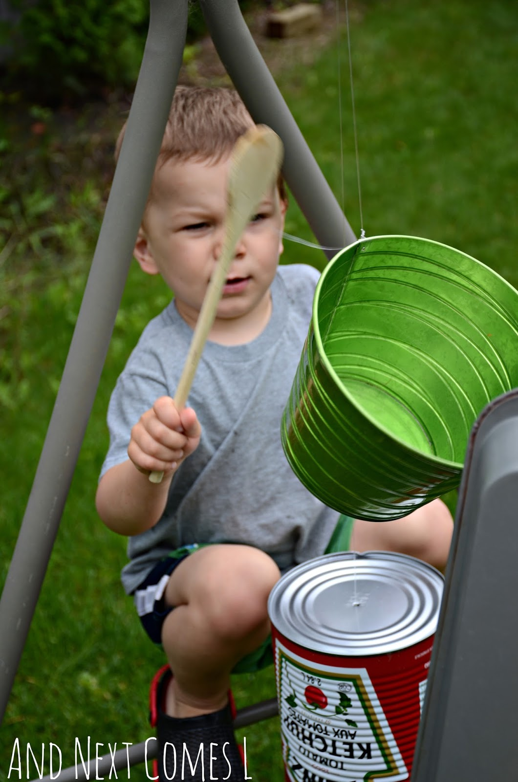 K playing on a DIY recycled outdoor music station from And Next Comes L
