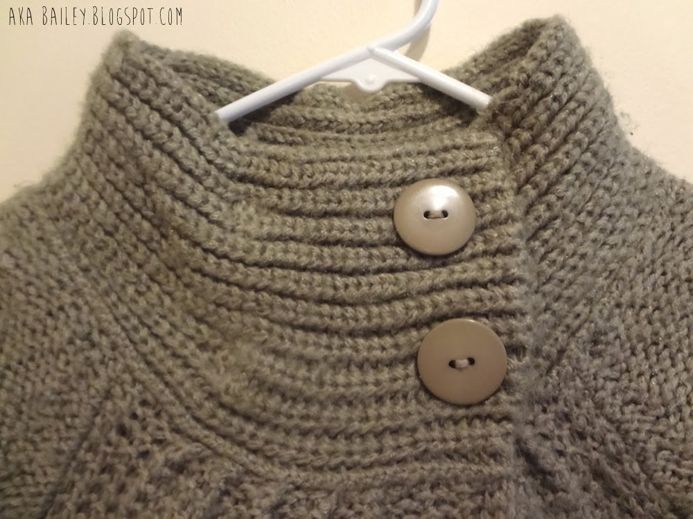 Taupe sweater with high color and two big buttons