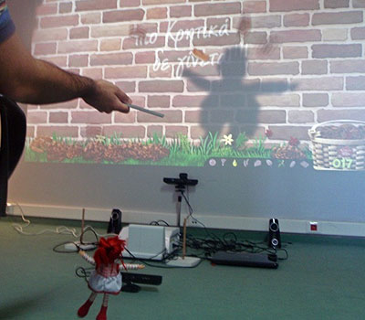 A Kinect game being played with a marionette as an alternative access method.