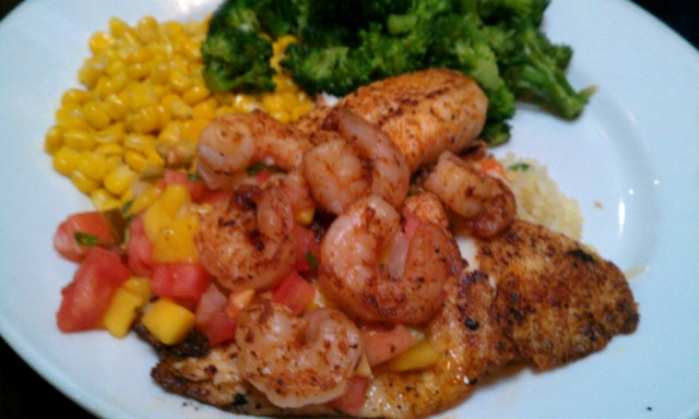 ... mango salsa top a generous fillet of grilled tilapia. Served with